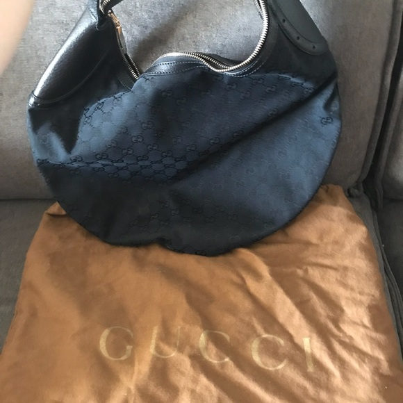 Gucci Bags - Authentic Gucci Monogram half moon hobo in Black